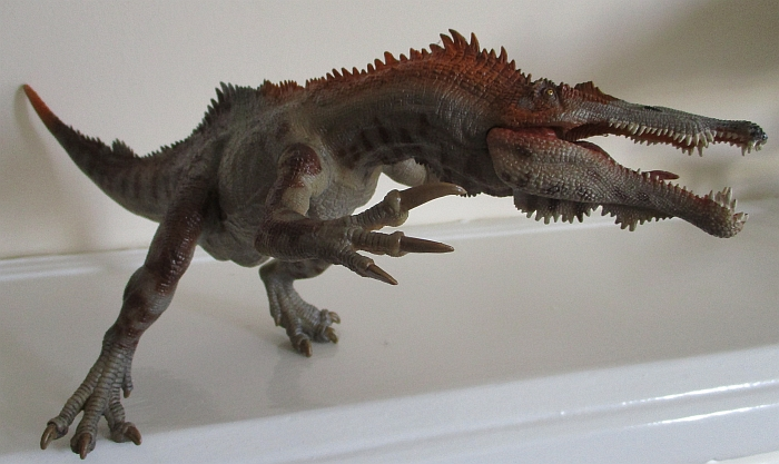 Papo Baryonyx propped against wall